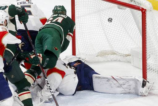 Minnesota Wild's Mikael Granlund, left, of Finland, falls onto Florida Panthers goalie James Reimer during the second period of an NHL hockey game Tuesday, Jan. 2, 2018, in St. Paul, Minn. Reimer was shaken up momentarily but returned to play.