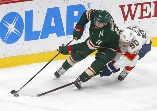Florida Panthers' Jared McCann, right, tries to reach the puck as he pursues Minnesota Wild's Zach Parise during the first period of an NHL hockey game Tuesday, Jan. 2, 2018, in St. Paul, Minn. It was Parise's first game this season after recovering from back surgery.