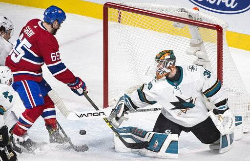 San Jose Sharks goaltender Aaron Dell is scored on by Montreal Canadiens' Andrew Shaw during the second period of an NHL hockey game in Montreal, Tuesday, Jan. 2, 2018. (Graham Hughes/The Canadian Press via AP)