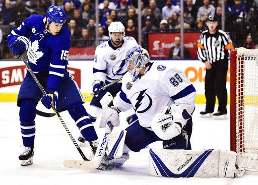 Tampa Bay Lightning goaltender Andrei Vasilevskiy (88) makes a save on Toronto Maple Leafs left wing Matt Martin (15) during the second period of an NHL hockey game Tuesday, Jan. 2, 2018, in Toronto. (Frank Gunn/The Canadian Press via AP)
