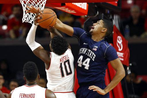 Penn State forward Julian Moore, right, attempts to block a shot attempt by Maryland guard Darryl Morsell in the first half of an NCAA college basketball game in College Park, Md., Tuesday, Jan. 2, 2018. (AP Photo/Patrick Semansky)