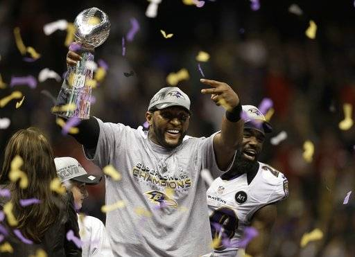 FILE - In this Feb. 3, 2013, file photo, Baltimore Ravens linebacker Ray Lewis holds up the Vince Lombardi Trophy as he celebrates with free safety Ed Reed (20) after the Ravens defeating the San Francisco 49ers 34-31 in the NFL football Super Bowl 47 in New Orleans. Star linebackers Lewis and Brian Urlacher are among four first-time eligible former players selected in the 15 modern-era finalists for the Pro Football Hall of Fame's Class of 2018. Receiver Randy Moss and guard Steve Hutchinson also made the cut to the finals as first-year eligibles.