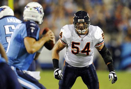FILE - In this Aug. 27, 2011, file photo, Chicago Bears linebacker Brian Urlacher (54) watches as Tennessee Titans quarterback Matt Hasselbeck drops back to pass during an NFL football preseason game in Nashville, Tenn. Star linebackers Ray Lewis and Urlacher are among four first-time eligible former players selected in the 15 modern-era finalists for the Pro Football Hall of Fame's Class of 2018. Receiver Randy Moss and guard Steve Hutchinson also made the cut to the finals as first-year eligibles.