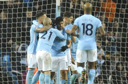 Manchester City's players celebrate after Manchester City's Sergio Aguero, third left, scores their side's third goal during the English Premier League soccer match between Manchester City and Watford at Etihad stadium, in Manchester, England, Tuesday, Jan. 2, 2018. (AP Photo/Rui Vieira)