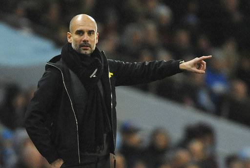 Manchester City's manager Pep Guardiola points during the English Premier League soccer match between Manchester City and Watford at Etihad stadium, in Manchester, England, Tuesday, Jan. 2, 2018. (AP Photo/Rui Vieira)