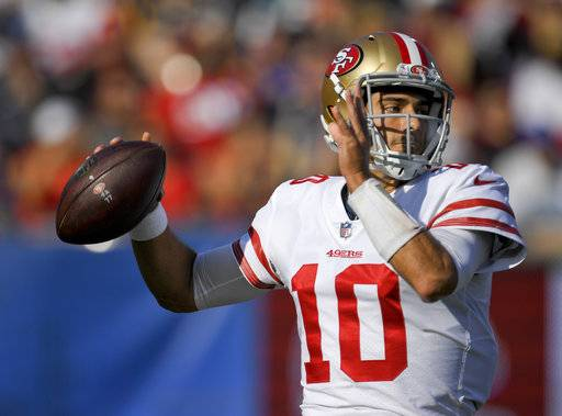 San Francisco 49ers quarterback Jimmy Garoppolo passes against the Los Angeles Rams during the first half of an NFL football game, Sunday, Dec. 31, 2017, in Los Angeles.