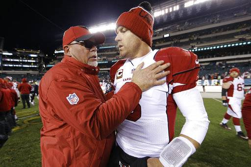 "FILE - In this Dec. 20, 2015, file photo, Arizona Cardinals coach Bruce Arians, left, meets with quarterback Carson Palmer after the team's NFL football game against the Philadelphia Eagles in Philadelphia. Palmer is retiring after 15 NFL seasons. Palmer, who turned 38 last week, made the announcement in an open letter released Tuesday, Jan. 2, 2018, by the Cardinals. Palmer missed the last nine games of what would be his final season with a broken left arm. He called his long professional career ""the most incredible experience of my life."" The statement came one day after Arians announced his retirement. Arians and Palmer spent the last five seasons together. (AP Photo/Matt Rourke, File)"