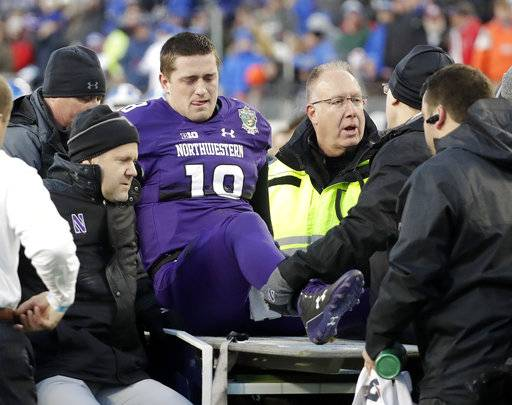 Northwestern quarterback Clayton Thorson (18) is put on a cart to be taken off the field after being injured in the first half of the Music City Bowl NCAA college football game against Kentucky, Friday, Dec. 29, 2017, in Nashville, Tenn.