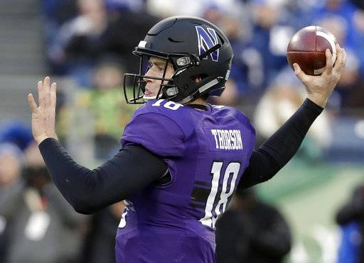 Northwestern quarterback Clayton Thorson passes against Kentucky in the first half of the Music City Bowl NCAA college football game Friday, Dec. 29, 2017, in Nashville, Tenn.