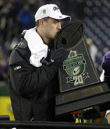 Northwestern quarterback Clayton Thorson kisses the trophy after Northwestern beat Kentucky 24-23 in the Music City Bowl NCAA college football game Friday, Dec. 29, 2017, in Nashville, Tenn. Thorson was injured during the game.
