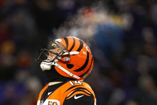 Cincinnati Bengals quarterback Andy Dalton (14) breath turns to steam as he reacts to a call during the first half of an NFL football game against the Baltimore Ravens in Baltimore, Sunday, Dec 31, 2017. (AP Photo/Patrick Semansky)