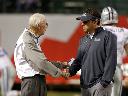 CORRECTS TO TUESDAY NOT SATURDAY Kansas State head coach Bill Snyder, left, and UCLA head coach Jedd Fisch talk before an NCAA college football bowl game, Tuesday, Dec. 26, 2017, in Phoenix.