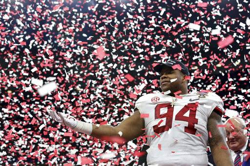 Alabama defensive lineman Da'Ron Payne (94) celebrates after being selected most valuable defensive player, after the Sugar Bowl semi-final playoff game against Clemson for the NCAA college football national championship, in New Orleans, Monday, Jan. 1, 2018. Alabama won 24-6 to advance to the national championship game. (AP Photo/Rusty Costanza)