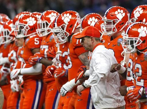 Clemson head coach Dabo Swinney lines up with his team before the Sugar Bowl semi-final playoff game against Alabama for the NCAA college football national championship, in New Orleans, Monday, Jan. 1, 2018.