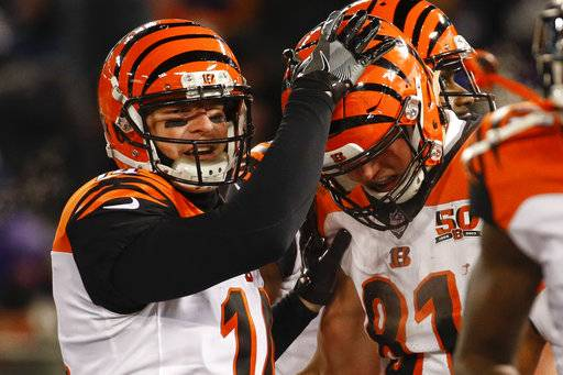 Cincinnati Bengals quarterback Andy Dalton (14) celebrates tight end Tyler Kroft's (81) touchdown reception during the first half of an NFL football game against the Baltimore Ravens in Baltimore, Sunday, Dec 31, 2017.