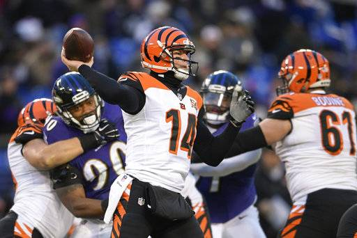 Cincinnati Bengals quarterback Andy Dalton (14) passes the ball during the first half of an NFL football game against the Baltimore Ravens in Baltimore, Sunday, Dec 31, 2017.