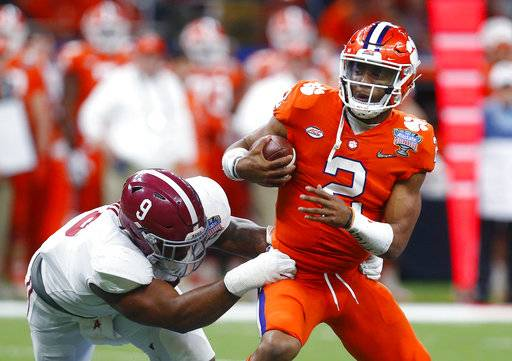 Clemson quarterback Kelly Bryant (2) is sacked by Alabama defensive lineman Da'Shawn Hand (9) in the second half of the Sugar Bowl semi-final playoff game for the NCAA college football national championship, in New Orleans, Monday, Jan. 1, 2018.