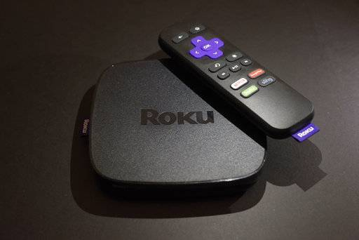 FILE - This Nov. 16, 2016 file photo shows the Roku Premiere streaming TV device in New York.  Roku plans to add a voice-controlled digital assistant to expanding lineup of online video players in an attempt to catch up with Google, Apple and Amazon. The internet-connected assistant will focus exclusively on fielding spoken request about video, music and other tasks tied to entertainment.
