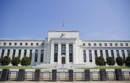 FILE - This Wednesday, Aug. 2, 2017, file photo shows the Federal Reserve Building on Constitution Avenue in Washington. The Federal Reserve releases minutes from its December meeting, on Wednesday, Jan. 3, 2018.