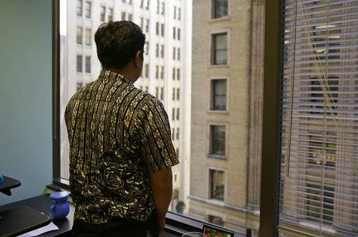 FILE - In this Sept. 22, 2016, file photo, Sorihin, who uses one name, one of two Indonesian fisherman who escaped slavery aboard a U.S.-flagged tuna and swordfish vessel when it docked at San Francisco's Fisherman's Wharf, looks out toward Montgomery Street at the offices of the Legal Aid Society in San Francisco. Attorneys for Sorihin and Abdul Fatah told The Associated Press on Wednesday, Jan. 3, 2018, that they settled their lawsuit against Thoai Van Nguyen, the California-based owner and captain of the Sea Queen II.
