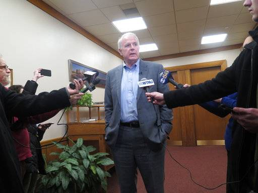 Milwaukee Mayor Tom Barrett speaks to reporters outside his office about the Red Cross asking fire victims in some parts of the city to come to them or a nearby police station on Tuesday, Jan. 2, 2018, in Milwaukee. The Red Cross Milwaukee chapter said the policy change is to address a volunteer shortage, but the move has sparked outrage because the areas affected are low-income and predominantly black and Latino.