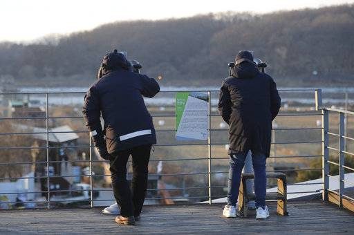 Visitors use binoculars to see the North side from the Imjingak Pavilion in Paju, South Korea, Wednesday, Jan. 3, 2018. North Korean leader Kim Jong Un reopened a key cross-border communication channel with South Korea for the first time in nearly two years Wednesday as the rivals explored the possibility of sitting down and talking after months of acrimony and fears of war.