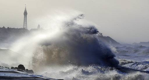 Big waves crash over the sea walls in Blackpool northwest England as a storm lashed the UK with violent storm-force winds of up to 100mph, leaving thousands of homes without power and hitting transport links Wednesday Jan. 3, 2018. (Peter Byrne/PA via AP)