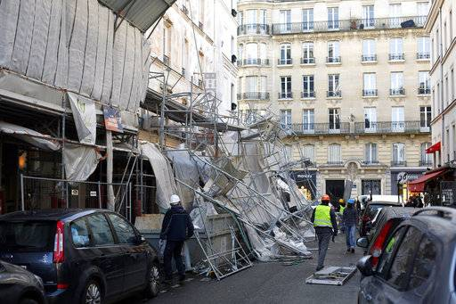 A scaffolding collapsed due to a violent windstorm, in Paris, Wednesday, Jan. 3, 2018, as France's national electricity provider reports 200,000 households without electricity across the country, including 30,000 in the Paris region due to storm damage. A severe storm packing winds of up to 100 miles per hour has battered much of Europe overnight and Wednesday morning, bringing heavy rain, hail and lightning to the region.