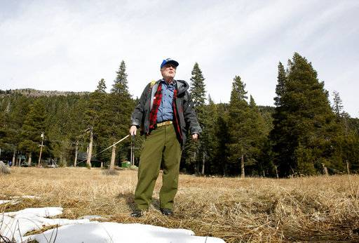 Frank Gehrke, chief of the California Cooperative Snow Surveys Program for the Department of Water Resources, looks over a nearly snow barren meadow while conducting the first snow survey of the season at the Phillips Station snow course, Wednesday, Jan. 3, 2018, near Echo Summit, Calif. The snow survey showed the snow pack at this location at 1.3 inches of depth with a water content of .4 inches. California's water managers are saying it's too early yet for fears that the state is sliding back into its historic five-year drought.