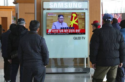 "People watch a TV screen showing North Korean leader Kim Jong Un's New Year's speech, at Seoul Railway Station in Seoul, South Korea, Wednesday, Jan. 3, 2018. North Korea announced Wednesday that it will reopen a cross-border communication channel with South Korea, officials in Seoul said, another sign of easing animosity between the rivals after a year that saw the North conduct nuclear bomb and missile tests and both the Koreas and Washington issue threats of war. The letters on the screen read: ""Welcomed South Korea's suggestions."""