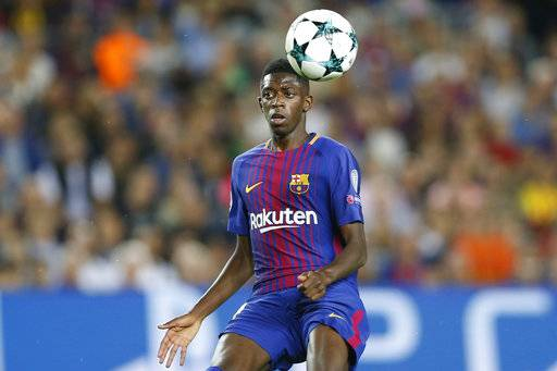 FILE - In this Sept. 12, 2017 file photo, Barcelona's Ousmane Dembele chases the ball during a Champions League group D soccer match between FC Barcelona and Juventus at the Camp Nou stadium in Barcelona, Spain. Dembele, the club's most expensive signing ever, is expected to make his much-anticipated return from a long injury layoff in a Copa del Rey match at Celta Vigo on Thursday Jan. 4, 2018.