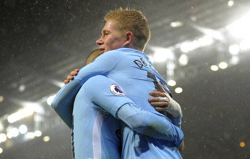 Manchester City's Kevin De Bruyne, right, celebrates with Manchester City's David Silva after Watford's Christian Kabasele scored an own goal during the English Premier League soccer match between Manchester City and Watford at Etihad stadium, in Manchester, England, Tuesday, Jan. 2, 2018.