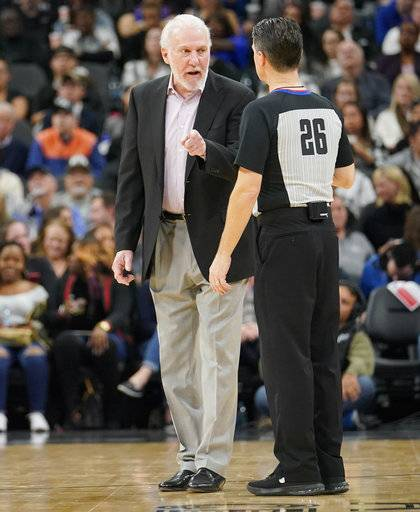 San Antonio Spurs head coach Gregg Popovich, left, talks to referee Pat Fraher during the second half of an NBA basketball game against the New York Knicks, Thursday, Dec. 28, 2017, in San Antonio.