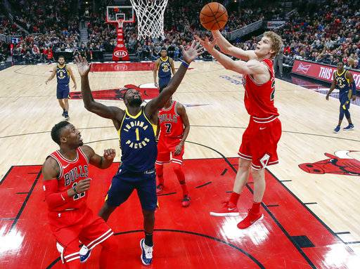 Chicago Bulls forward Lauri Markkanen (24) grabs a rebound against Indiana Pacers guard Lance Stephenson (1) during the second half of an NBA basketball game, Friday, Dec. 29, 2017, in Chicago.