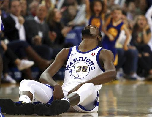 Golden State Warriors' Kevin Durant looks up from the floor after a foul was called in his favor during the second half of the team's NBA basketball game against the Charlotte Hornets on Friday, Dec. 29, 2017, in Oakland, Calif. Charlotte won 111-100.