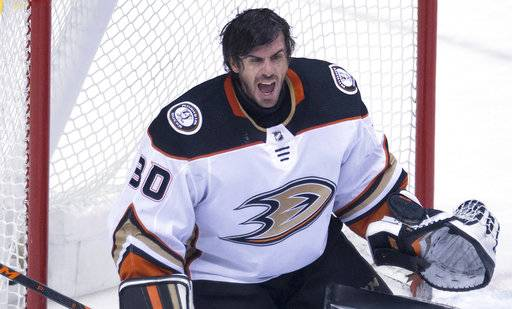 Anaheim Ducks goaltender Ryan Miller (30) yells after losing his mask during the third period of an NHL hockey game against the Vancouver Canucks on Tuesday, Jan. 2, 2018, in Vancouver, British Columbia. (Jonathan Hayward/The Canadian Press via AP)