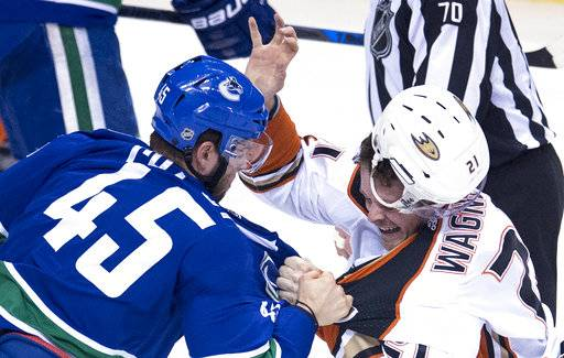 Vancouver Canucks center Michael Chaput (45) fights with Anaheim Ducks centre Chris Wagner (21) during the second period of an NHL hockey game Tuesday, Jan. 2, 2018, in Vancouver, British Columbia. (Jonathan Hayward/The Canadian Press via AP)
