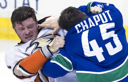 Vancouver Canucks center Michael Chaput (45) fights with Anaheim Ducks centre Chris Wagner during the second period of an NHL hockey game Tuesday, Jan. 2, 2018, in Vancouver, British Columbia. (Jonathan Hayward/The Canadian Press via AP)