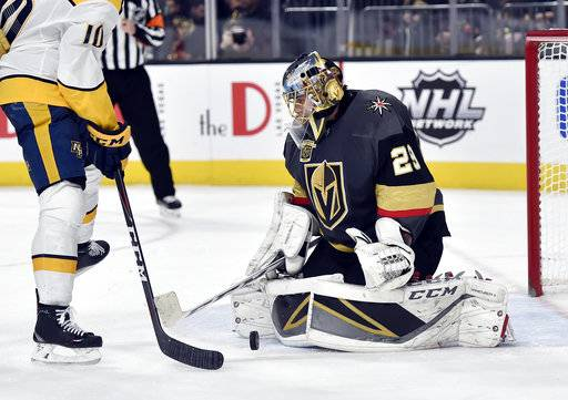 Vegas Golden Knights goalie Marc-Andre Fleury (29) blocks a shot by the Nashville Predators during the third period of an NHL hockey game Tuesday, Jan. 2, 2018, in Las Vegas. The Golden Knights won 3-0.