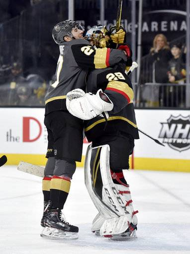 Vegas Golden Knights defenseman Shea Theodore (27) congratulates goalie Marc-Andre Fleury after the Golden Knights defeated the Nashville Predators 3-0 in an NHL hockey game Tuesday, Jan. 2, 2018, in Las Vegas.