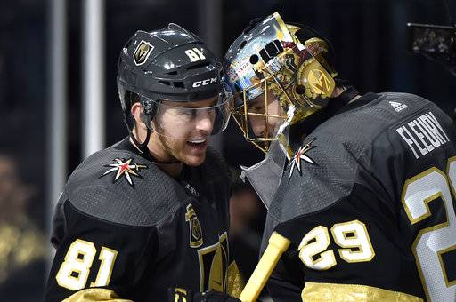 Vegas Golden Knights center Jonathan Marchessault (81) congratulates goalie Marc-Andre Fleury after an NHL hockey game against the Nashville Predators on Tuesday, Jan. 2, 2018, in Las Vegas. The Golden Knights won 3-0.