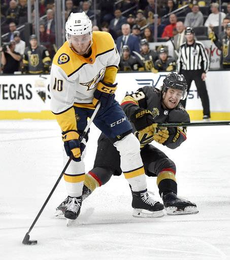 Nashville Predators center Colton Sissons (10) skates with the puck under pressure from Vegas Golden Knights left wing Brendan Leipsic during the third period of an NHL hockey game Tuesday, Jan. 2, 2018, in Las Vegas. The Golden Knights won 3-0.