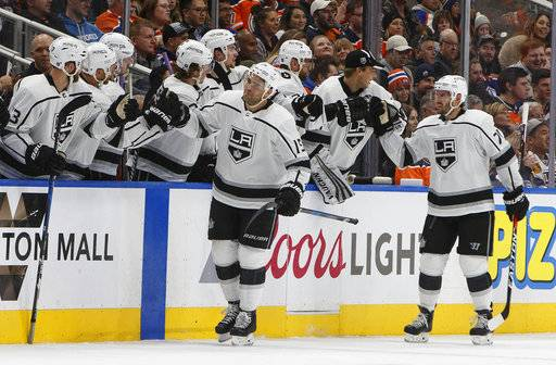 Los Angeles Kings' Andy Andreoff (15) and Torrey Mitchell (71) celebrate a goal against the Edmonton Oilers during the second period of an NHL hockey game in Edmonton, Alberta, Tuesday, Jan. 2, 2018. (Jason Franson/The Canadian Press via AP)