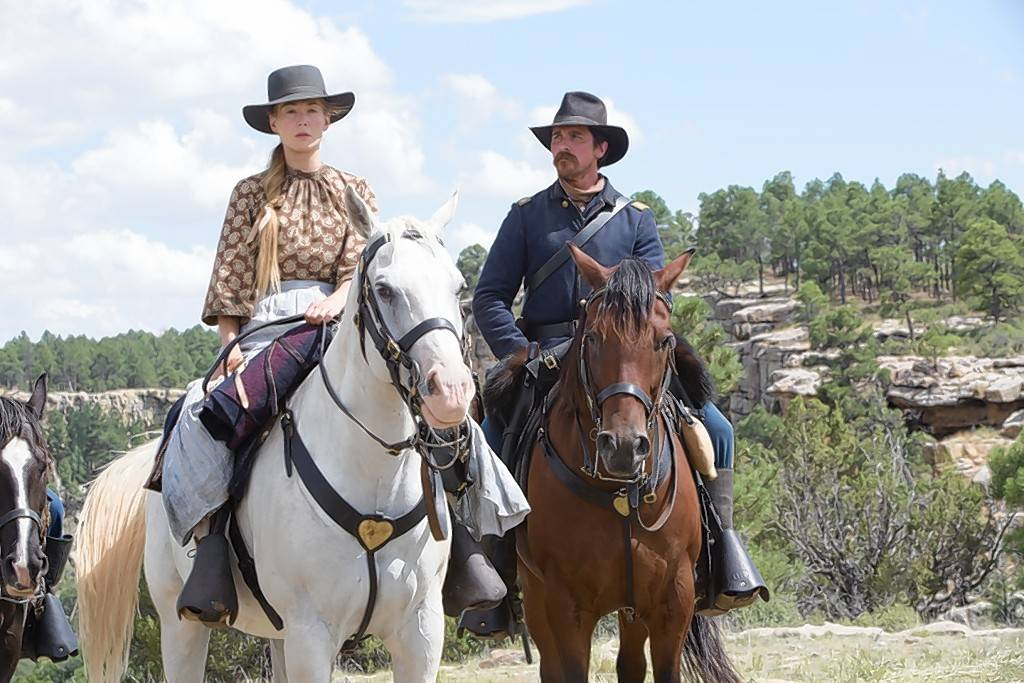 "Rosamund Pike plays a pioneer rescued by a U.S. army captain (Christian Bale) in the violent Western ""Hostiles."""