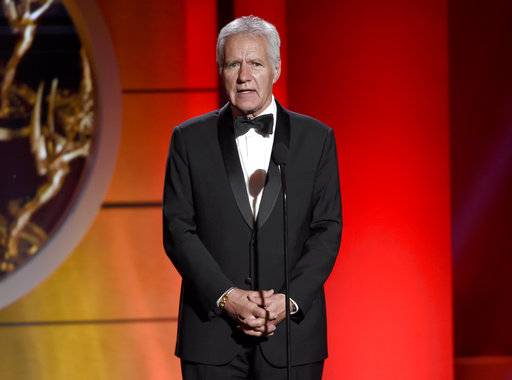 "FILE - In this April 30, 2017 file photo, Alex Trebek speaks at the 44th annual Daytime Emmy Awards at the Pasadena Civic Center in Pasadena, Calif. Longtime ""Jeopardy� host Trebek had surgery for blood clots on the brain, but says he'll be back behind the podium soon. Trebek appeared in a video on the ""Jeopardy� Facebook page Thursday, Jan. 5, 2018, to announce that he'd had the surgery during the show's holiday break. (Photo by Chris Pizzello/Invision/AP, File)"