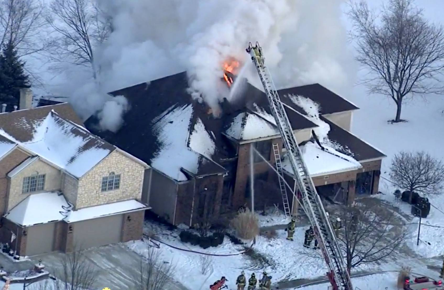 COURTESY OF ABC 7 Firefighters battle a Naperville fire Thursday afternoon.