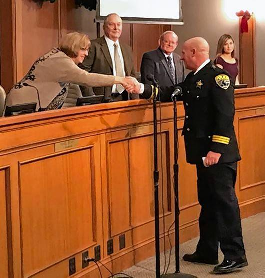 New Mount Prospect Police Chief John Koziol, right, shakes hands with Mayor Arlene Juracek on Wednesday after his swearing-in ceremony.