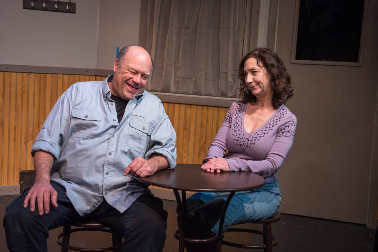 "Lou, played by William Smith, enjoys the company of Doreen Dawson's Stella in Village Theatre Guild's production of ""Stella and Lou,"" a humorous, hopeful story about relationships."