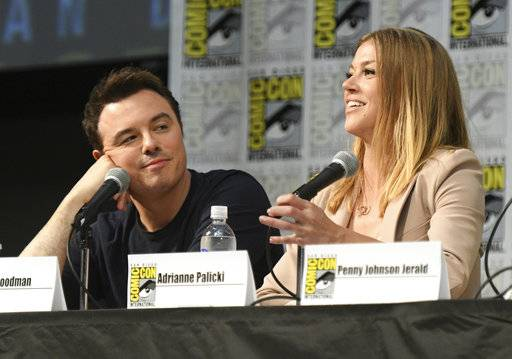 "FILE - In a Saturday, July 22, 2017 file photo, Seth MacFarlane, left, and Adrianne Palicki attend the ""The Orville"" panel on day three of Comic-Con International, in San Diego. The Fox broadcasting network, home to ""The Simpsons"" and ""The Orville,"" will continue to carry scripted entertainment after its sale to Disney. Fox Television Group CEOs Dana Walden and Gary Newman said the announced sale that will split up Fox and the 20th Century Fox studio won't turn Fox into a platform solely for sports and other live programming. In Dec. 2017, Disney said it was buying a large part of the Murdoch family's 21st Century Fox for about $52.4 billion in stock, including its film and TV studios and cable and international TV businesses.  (Photo by Al Powers/Invision/AP, File)"