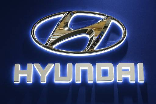 FILE - This Thursday, Feb. 11, 2016, file photo shows the Hyundai logo on display at the Pittsburgh International Auto Show in Pittsburgh. Hyundai and Volkswagen each say they're partnering with a U.S. autonomous vehicle tech firm led by former executives from Google, Tesla and Uber. On Thursday, Jan. 4, 2018, the companies announced partnerships with Aurora Innovation, started in 2017 by ex-Google autonomous car chief Chris Urmson and others. (AP Photo/Gene J. Puskar, File)